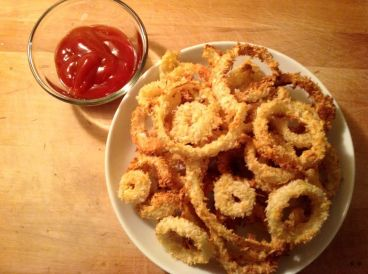"""PBR Battered Baked Onion Rings: """"I've never managed to make good fries at home, so these will definitely be my go-to side dish for burgers, reubens, and grilled cheese. Very delicious — very easy. And the extended beer-soak is essential!"""" -Tom N., Montreal, Canada"""